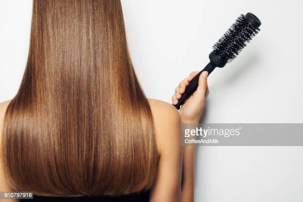 woman standing with her back and demonstrates luxurious hairstyle - long hair stock pictures, royalty-free photos & images