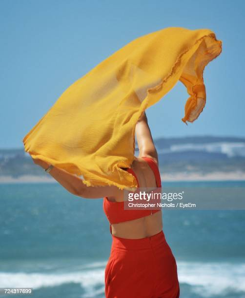 Woman Standing With Yellow Shawl