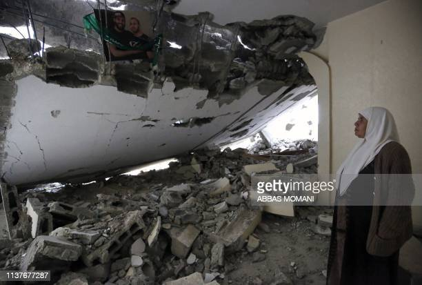 TOPSHOT A woman stands amidst debris at the house of Palestinian assailant Salah Barghouti after it was partially demolished by Israeli forces in the...