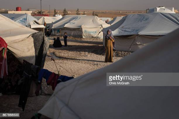 A woman stands amongst tents at a camp for internally displaced people on October 29 2017 in Ain Issa Syria Following three and a half months of...