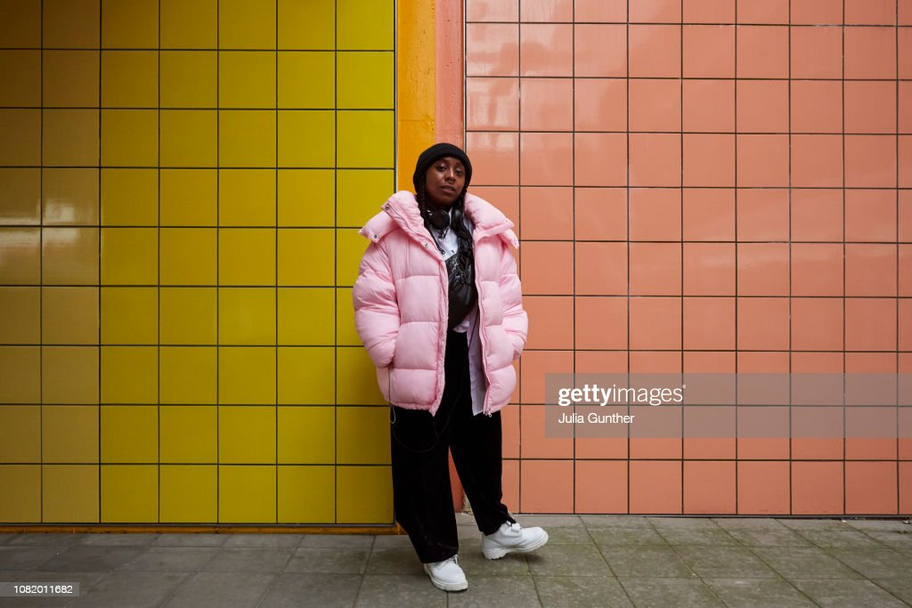 Woman stands at subway station : Stock Photo