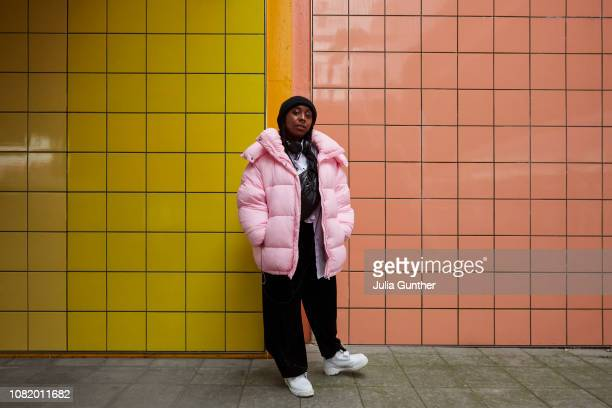 Woman stands at subway station