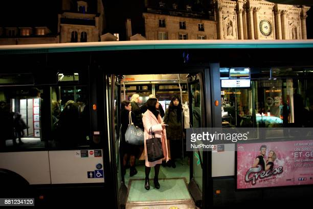 A woman stands at the door of a bus in Paris France on November 24 2017