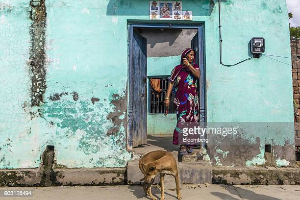 A woman stands at the entrance to a house in Sambhal Uttar Pradesh India on Monday Aug 22 2016 Prime Minister Narendra Modi's Hindunationalist...