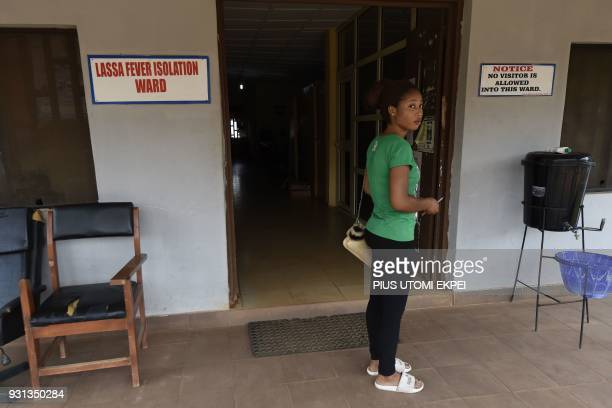 A woman stands at the entrance to a Lassa fever isolation ward at the Institute of Lassa Fever Research and Control in Irrua Specialist Teaching...