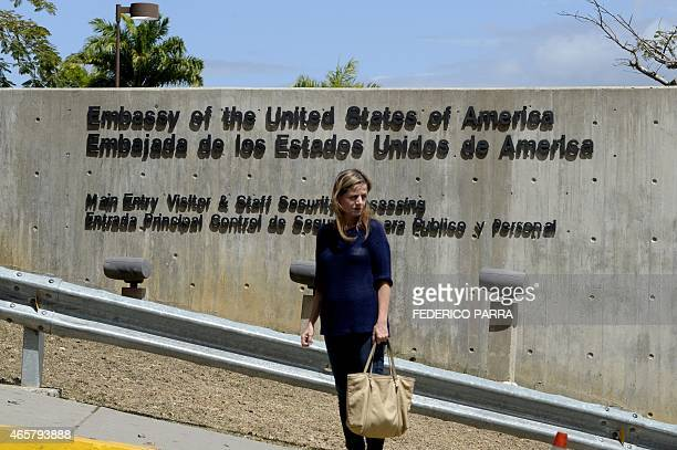 A woman stands at the entrance to the US Embassy in Caracas on March 10 2015 Venezuelan President Nicolas Maduro was set to request special...
