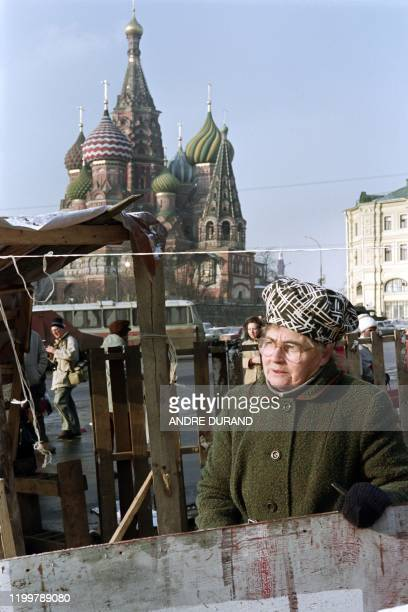 Woman stands behind a self-made shelter in front of a monument, on November 15, 1990 in Moscow, as the Russian market liberalisation led to a...
