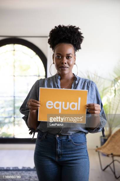 woman stands for equal rights - anti racism stock pictures, royalty-free photos & images