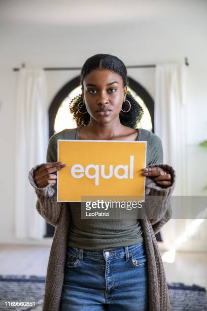 woman stands for equal rights - racism stock pictures, royalty-free photos & images