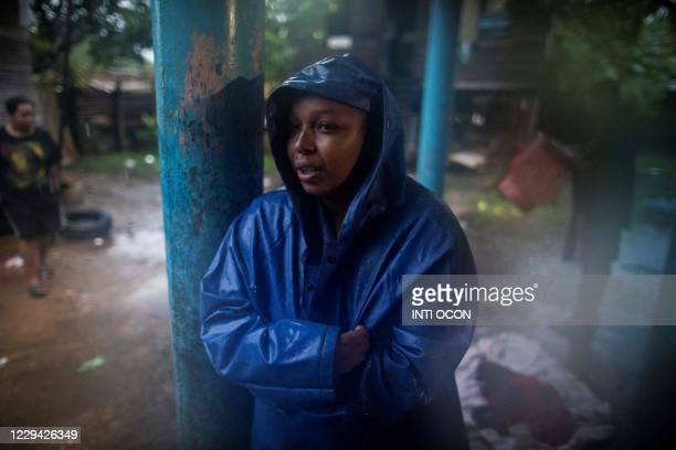 Woman stands in a shelter while waiting for the passage of Hurricane Eta, in Bilwi, Puerto Cabezas, Nicaragua, on November 2, 2020. - Eta rapidly...