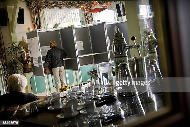 A woman stands in a voting booth on June 4 2009 in the Dutch city of Zaanstad during the European Parliament elections Alongside Britain the...