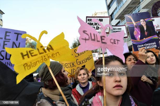 A woman stands in front of a placard during a protest on the occasion of the International Day for the Elimination of Violence against Women in...