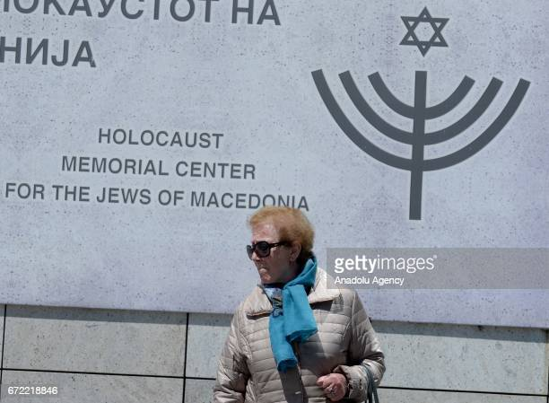 A woman stands in front of Holocaust Museum during the Yom HaShoah Holocaust Remembrance Day in Skopje Macedonia on April 24 2017 Holocaust...
