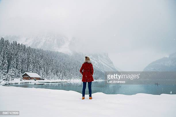 woman stands in front of Lake Louise Alberta