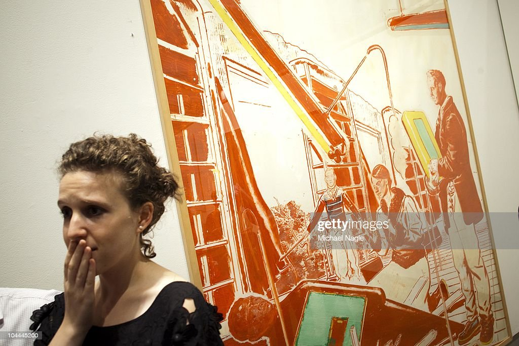 A woman stands in front of Neo Rauch's 'Einbruch' as it, and other art from Lehman Brothers' collection, is auctioned off at Sotheby's on September 25, 2010 in New York City. The sales from the Sotheby's auction and upcoming auctions at Christie's in London and Freeman's in Philadelphia would be used to repay creditors of the collapsed investment bank group.