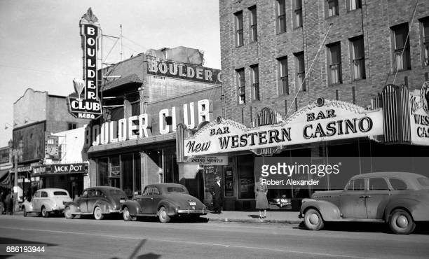Woman stands in front of New Western Casino and Boulder Club on Fremont Avenue in Las Vegas, Nevada, circa 1940. The Boulder Club was built in 1929...