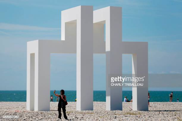 A woman stands in front of the art installation 'Up#3' by Sabina Lang and Daniel Baumann installed for the celebration of the 500th anniversary of...