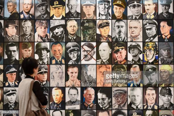 A woman stands in front of the installation 'Real Nazis' created by Polish artist Piotr Uklanski in the Neue Galerie in Kassel central Germany on...