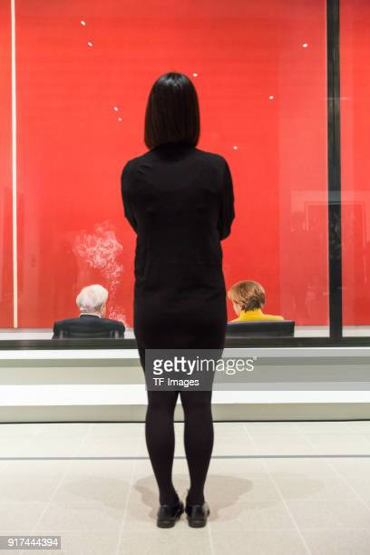 A woman stands in front of the piece called 'Review' by Andreas Gursky in the reopened Hayward Gallery on January 24 2018 in London England