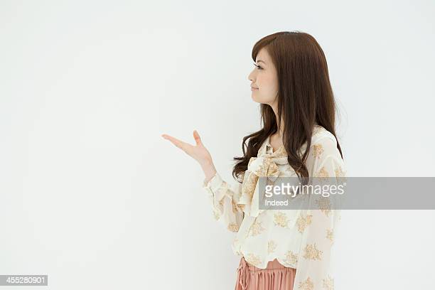 woman stands in front of white background - 前にいる ストックフォトと画像