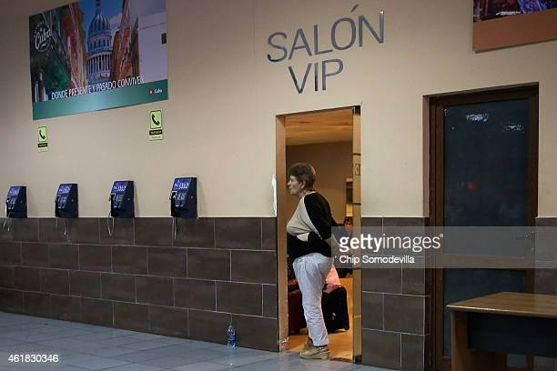 Woman stands in the doorway of the VIP lounge at Jose Marti International Airport January 19, 2015 in Havana, Cuba. Officials from the Cuban and...