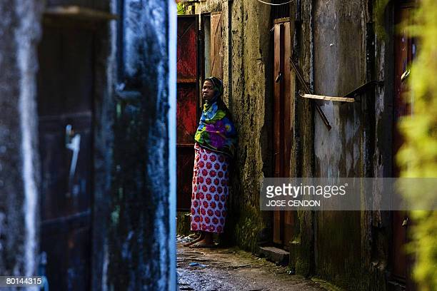 A woman stands in the old city of Moroni the capital of the Union of Comoros on March 5 2008 African Union envoy to the Comoros Mourad Taiati said...