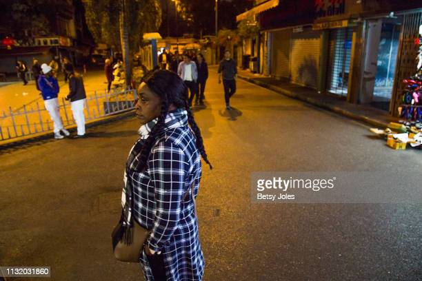 Woman stands near New Don Franc Hotel, part of an ethnically diverse quarter of Guangzhou known as Little Africa on February 3, 2019 in Guangzhou,...