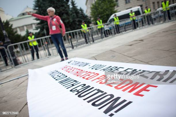 Woman stands near quotPiS zonequot inscription during quotSupermothers Dayquot support action of RON strike in Warsaw on May 26 2018