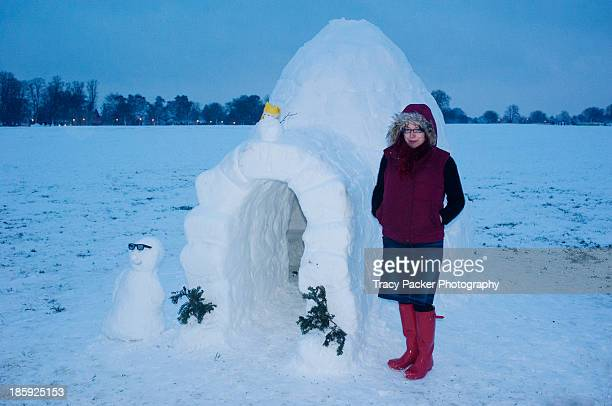 A woman stands next to an igloo in Bristol.