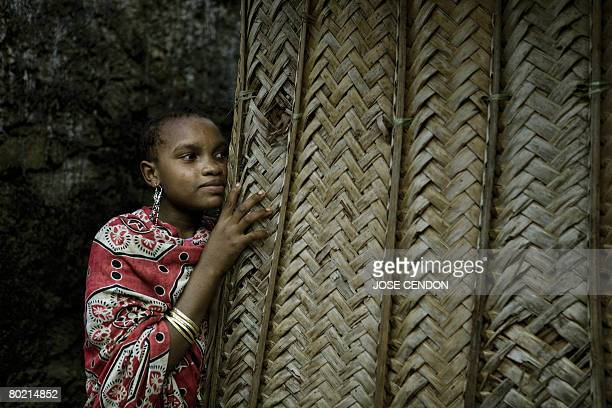 A woman stands on 12 March 2008 in a street in Hoani near Mutsamudu the capital of Anjouan where renegade Anjouan President Mohamed Bacar lives...