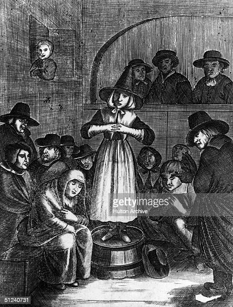 Woman stands on a barrel in order to address a meeting of the Quakers, or Religious Society of Friends, circa 1720.