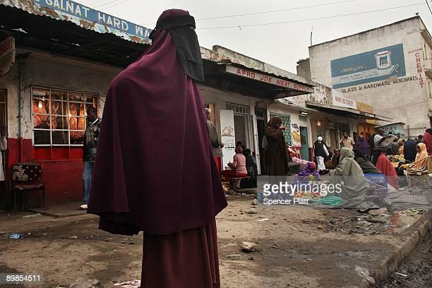 Woman stands on a street corner in Eastleigh, a predominantly Muslim Somali neighborhood on August 18, 2009 in Nairobi, Kenya. Referred to locally as...