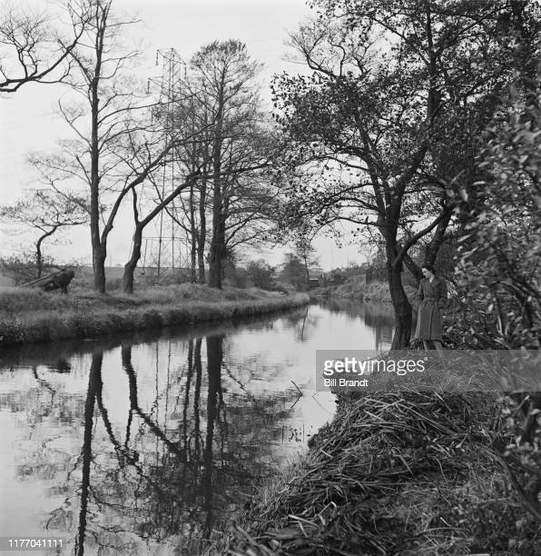 A woman stands on the bank of the River Tawe in the Swansea Valley south Wales 1943 Original Publication Picture Post story 1448 The Story of the...