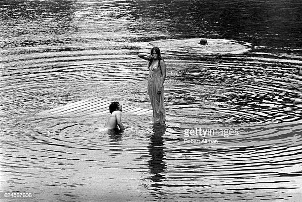 A woman stands on the water known as The Lady on the Lake during the Alternative Media Conference at Goddard College in June 1970 in Plainfield...