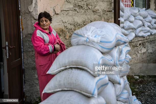 Woman stands outside a shelter in the city of Stepanakert on October 10 during the ongoing military conflict between Armenia and Azerbaijan over the...
