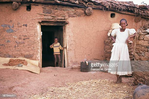A woman stands outside her home in Asmara Ethiopia April 1973