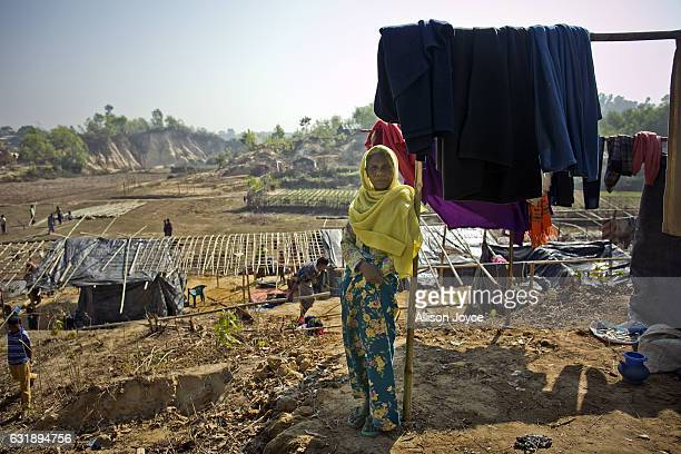 A woman stands outside her home in the Balu Kali refugee camp on January 17 2017 in Cox's Bazar Bangladesh More than 65000 Rohingya Muslims have fled...