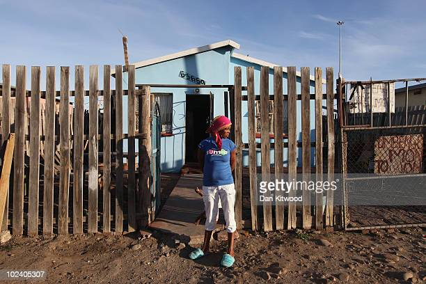 Woman stands outside her home in the New Brighton Township on June 24, 2010 in Port Elizabeth, South Africa. The New Brighton Township was...