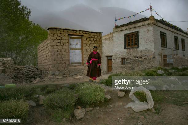 A woman stands outside her home in Yarat village which is dependent on solar energy on June 14 2017 in Ladakh India The cold desert of Ladakh has...