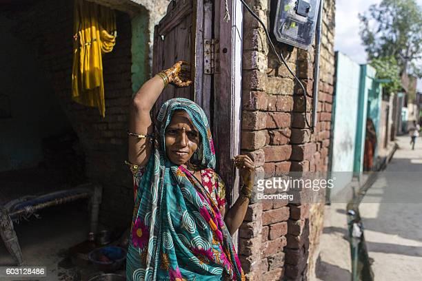 A woman stands outside her house in Sambhal Uttar Pradesh India on Monday Aug 22 2016 Prime Minister Narendra Modi's Hindunationalist Bharatiya...