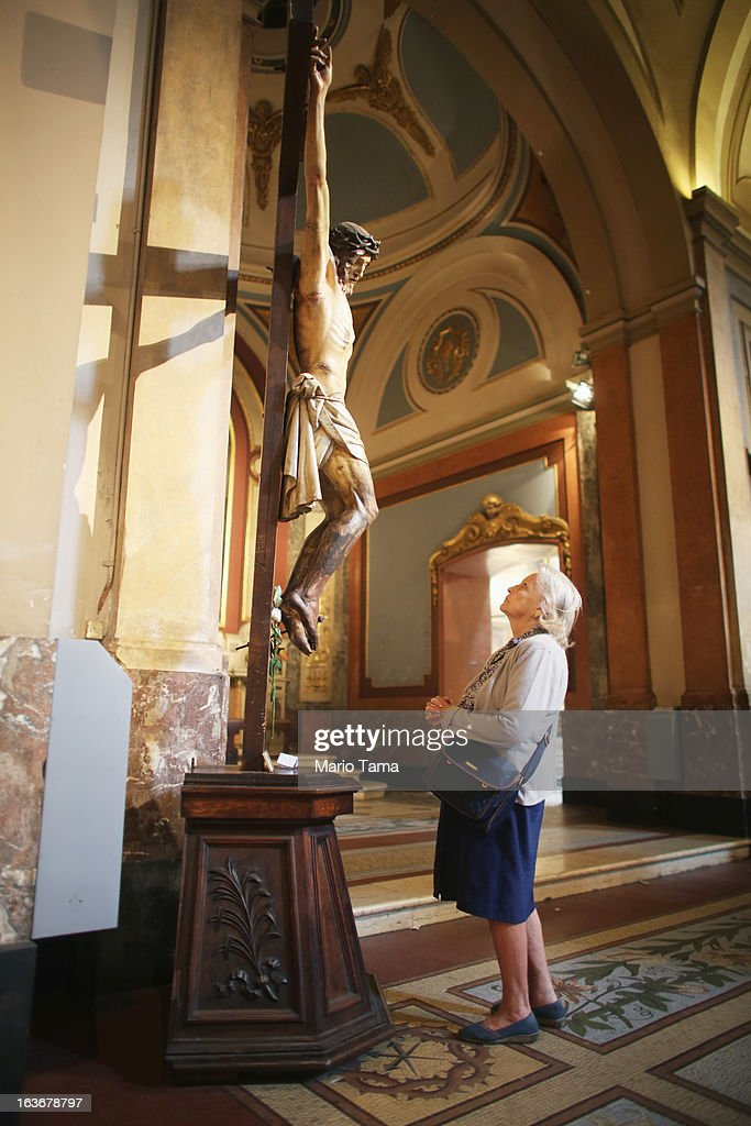 A woman stands under a crucifix of Jesus in the Metropolitan Cathedral following Mass on the day after Pope Francis, formerly Cardinal Jorge Mario Bergoglio, was elected at the conclave on March 14, 2013 in Buenos Aires, Argentina. Francis was the archbishop of Buenos Aires and is the first Pope to hail from South America.