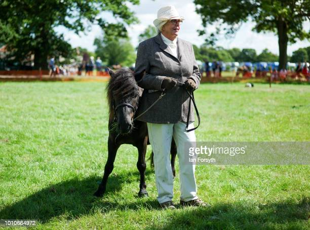 A woman stands waiting to enter the main ring during 152nd the Ryedale Country Show on July 31 2018 in Kirbymoorside England Held in Welburn Park...