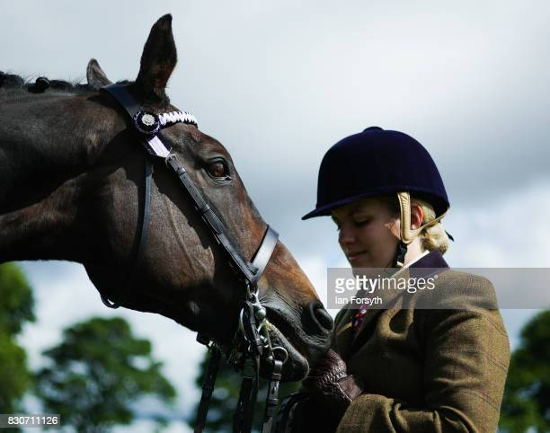 A woman stands with her horse during the 194th Sedgefield Show on August 12 2017 in Sedgefield England The annual show is held on the second Saturday...