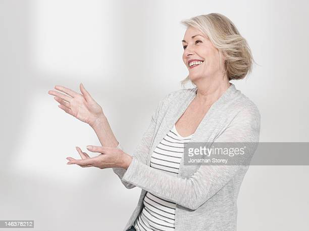 Woman stanging talking to someone out of shot