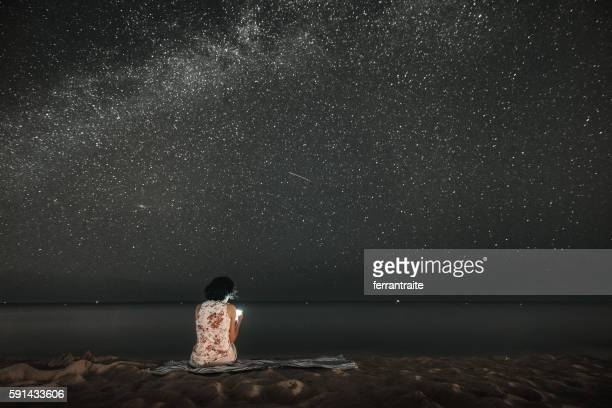 Woman Stargazing on the Beach