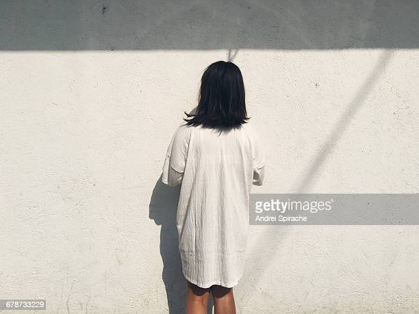 Woman staring at a wall