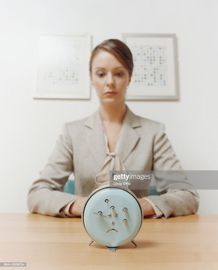 Woman Staring at Alarm Clock : Stock Photo