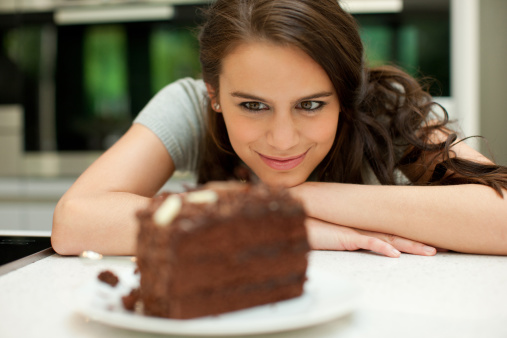 Woman staring at chocolate cake - gettyimageskorea