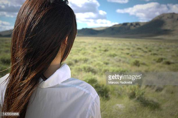 woman staring at huge landscape - radicella stock photos and pictures