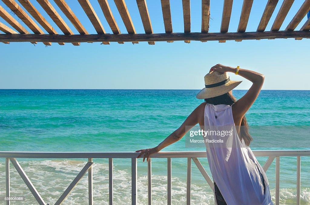 Woman staring at the sea, Cayo Coco, Cuba. : Stock Photo